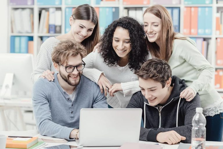 group-of-students-connecting-with-a-laptop